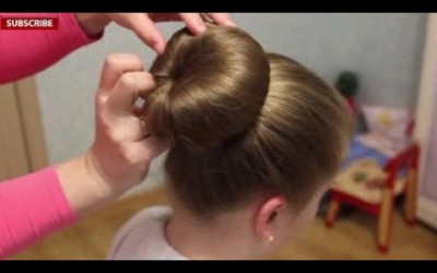 Hairstyles-for-long-hair-Beautiful-beam-with-roller-and-belt-1